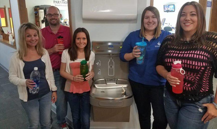 Staff celebrating new water fountain